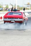 Smoke show. Picture of javelin AMX burning rubber during drag race stock photos