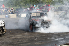 Smoke show. Napierville demolition derby, July 12, 2015, picture of wrecked car making a smoke show during the demolition derby stock photos