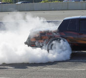 Smoke show. Picture of chevrolet monte carlo during burnout competition - smoke show Royalty Free Stock Photos