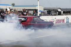 Smoke show on the track Stock Images