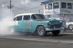 Drag racing. Picture of vintage chevrolet drag car making a smoke show on the track Royalty Free Stock Photos