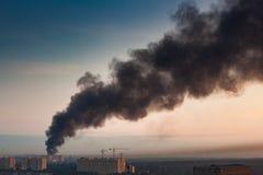Smoke at sky Stock Images