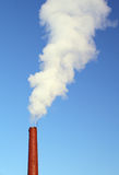 Smoke stack. On a blue sky background Stock Images