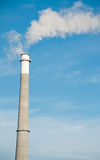 Smoke Stack. A Tall Smoke Stack Releasing Pollution into the Sky stock photography