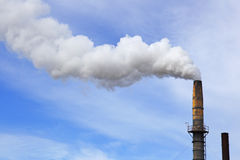 Smoke stack blue sky royalty free stock photography