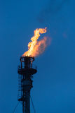 Smoke stack. Burning flare at oil refinery Royalty Free Stock Images