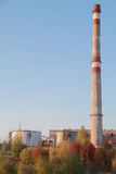 Smoke stack on the fabric in Russia, autumn Royalty Free Stock Photography