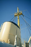 Smoke stack and mast of industrial ship Stock Photography
