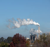 A smoke stack at an oil refinery Royalty Free Stock Photos