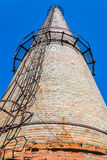Smoke Stack. Old Industrial Smoke Stack from a red brick Stock Image