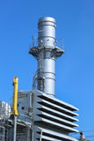 Smoke stack in power generator plant with blue sky Stock Image