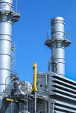 Smoke stack in power generator plant with blue sky Stock Photos