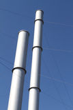 Smoke Stacks. Idle smoke stacks supported by metal wires Stock Photography