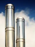 Smoke stacks. Industrial smoke stacks over blue sky royalty free stock image