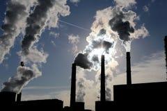 Smoke stacks at coal burning power plant Stock Photography