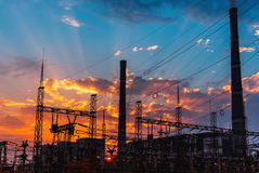 Smoke stacks at coal burning power plant, industrial silhouette. stock photos