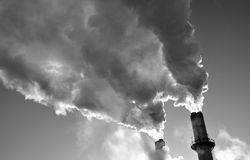 Smoke stacks cold morning. Power plant smoke stacks early on a cold January morning Royalty Free Stock Image