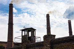 Smoke stacks of the industrial plant Royalty Free Stock Image