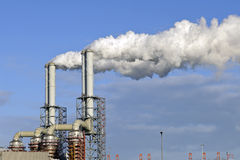 Smoke stacks of a oil refinery Royalty Free Stock Image