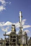 Smoke stacks from an oil refinery Stock Photos
