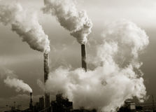 Smoke stacks polluting the planet Stock Photos