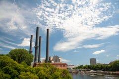 Smoke stacks on the river Royalty Free Stock Photo