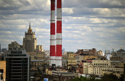 Smoke Stacks and the Russian Ministry of Foreign Affairs in Moscow, Russia. Massive, striped smoke stacks loom over theMinistry of Foreign Affairs in Moscow Stock Photography