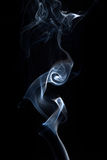 Smoke or steam on black Royalty Free Stock Photo