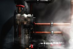 Smoke and steam in a boiler room Royalty Free Stock Photography