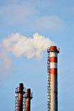 Smoke and steam comes out from factory chimney Stock Photo