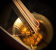 Smoke Sticks Burning Out in Gold Bowl with Fire. Asian Religion Aroma Sticks for Praying Royalty Free Stock Photo