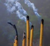Smoke Sticks Burning Out with Silky Smoke. Asian Religion Aroma Sticks for Praying Royalty Free Stock Photo