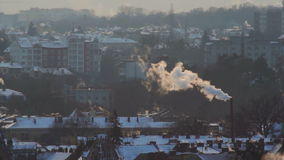 Smoke sun roof city. The sun breaks through the clouds,building in a small haze , the smoke over the city stock footage