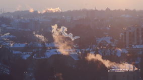 Smoke sun roof city. The sun breaks through the clouds, building in a small haze , the smoke over the city stock footage