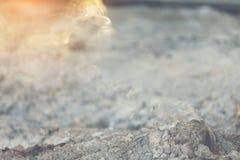 Smoke. Sunlight shining to ash smoke in the morning Stock Image