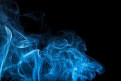 Smoke Swirl. Trail of smoke over black background Royalty Free Stock Photography