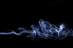 Smoke swirl. On black background Stock Photography