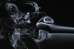 Smoke swirl on a black background Stock Image