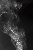 Smoke swirling on a black background Royalty Free Stock Photography