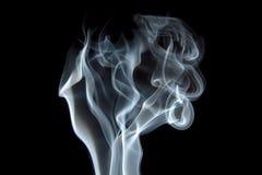 Smoke curls on black. Smoke swirls on black background royalty free stock image