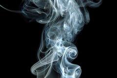 Smoke curls on black. Smoke swirls on black background royalty free stock photo