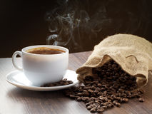 Smoke taking away from coffee Stock Photography