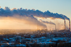 Smoke from thermal power plants rises above city Stock Image