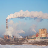 Smoke of thermal station. Frosty (cold) day. Royalty Free Stock Image