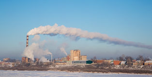 Smoke of thermal station. Frosty (cold) day. Royalty Free Stock Photography
