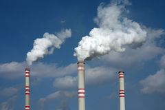 Smoke from three  power plant chimney Royalty Free Stock Images
