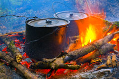Smoke tourist kettles on fire Royalty Free Stock Photo