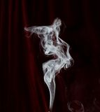 Smoke trail. White smoke trail on dark background stock images