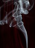 Smoke trail. White smoke trail on dark background royalty free stock photography