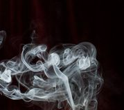 Smoke trail. White smoke trail on dark background stock image